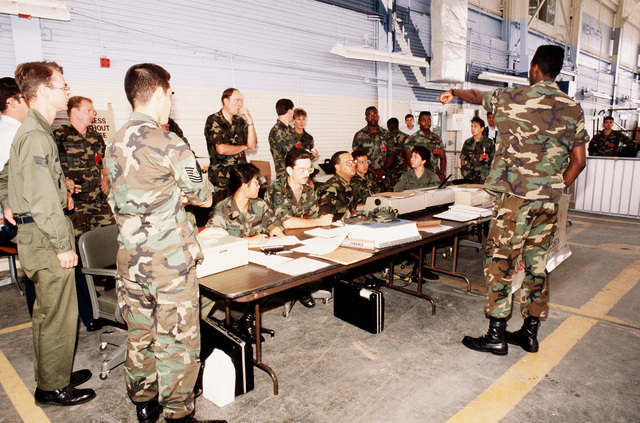 A personnel processing station is organized to update the pay and service records of airmen deploying to Saudi Arabia for Operation Desert Shield