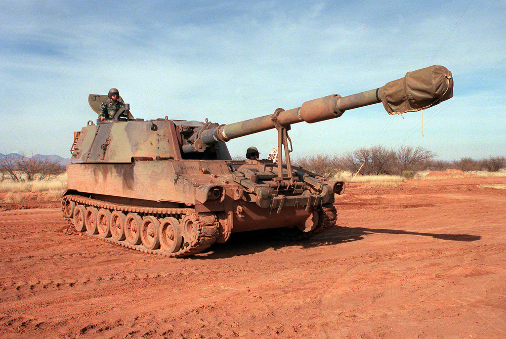 A right front view of an M-109A2 self-propelled 155mm howitzer during the testing of an anti-mine system