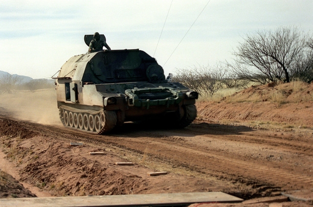 An M-992 field artillery ammunition support vehicle (FAASV) is driven down a road during the testing of an anti-mine system