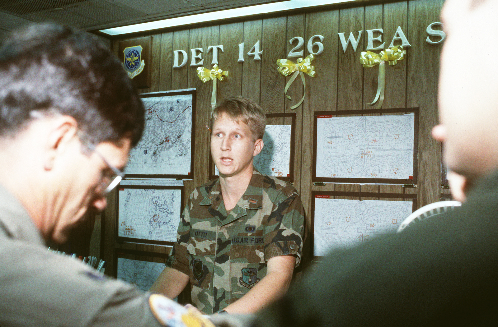 Second LT. Walter Otto, center, a weather officer with Detachment 14, 26th Weather Squadron, briefs an air crew on current and expected weather conditions prior to the crew's flight to the Persian Gulf region in support of Operation Desert Shield