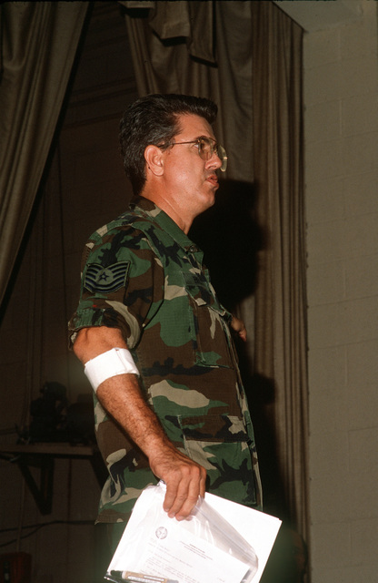 TECH. SGT. Dan Bruen of the 834th Mission Support Squadron delivers a briefing to personnel about to deploy to the Persian Gulf region for Operation Desert Shield