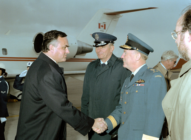 Ramon J. Hnatyshyn, governor general of Canada, is greeted by LGEN Robert W. Morton, deputy commander-in-chief, North American Air Defense Command (NORAD), as GEN Donald J. Kutyna, NORAD commander-in-chief, looks on