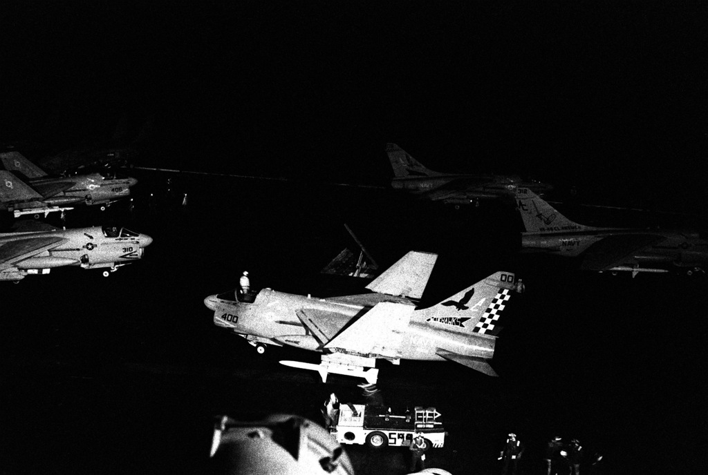 A-7E Corsair aircraft of Attack Squadron 72 (VA-72), foreground, and Attack Squadron 46 (VA-46) prepare for a night launch from the aircraft carrier USS JOHN F. KENNEDY (CV-67) at the beginning of Operation Desert Storm. The VA-72 aircraft is carrying an AGM-88A HARM high-speed anti-radiation missile