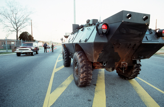 A V-100 Commando armored vehicle patrols the roadway in an effort to strengthen base security following the outbreak of Operation Desert Storm hostilities between the Allied Forces and Iraq