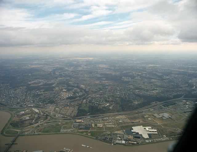 An aerial view of the Anacostia River, Anacostia Naval Station and Bolling Air Force Base. The Frederick Douglass Memorial Bridge crosses the Anacostia at left