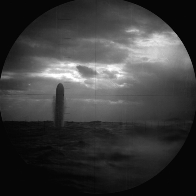 As seen through the submarine's periscope, a BGM-109 Tomahawk land attack missile (TLAM) targeted on an Iraqi position rises out of the water after being fired from a vertical launch tube aboard the nuclear-powered attack submarine USS PITTSBURGH (SSN-720) during Operation Desert Storm