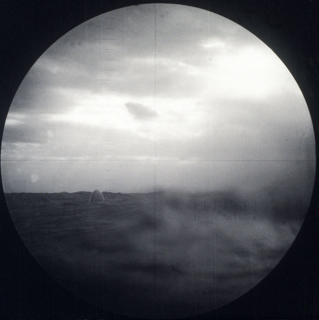 As seen through the submarine's periscope, the nose of a BGM-109 Tomahawk Land Attack Missile (TLAM) targeted on an Iraqi position emerges from the water after being fired from a vertical launch tube aboard the nuclear-powered attack submarine USS PITTSBURGH (SSN-720) during Operation Desert Storm. (First in a series of nine views.)