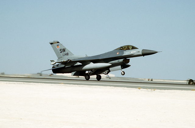 An F-16C Fighting Falcon fighter aircraft of the 363rd Tactical Fighter Wing, Shaw Air Force Base, S.C., takes off for a mission in support of Operation Desert Storm. The aircraft is armed with AIM-9 Sidewinder air-to-air missiles on its wing tips.