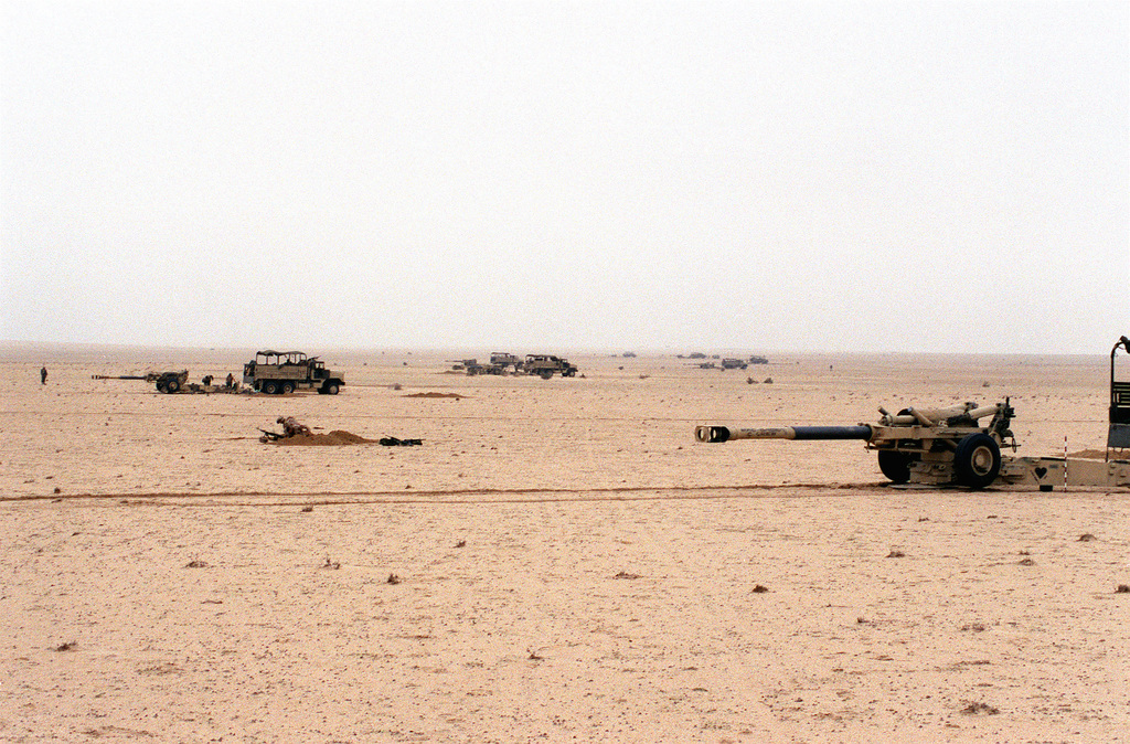 M-198 155mm howitzers are moved into position for a firing mission against Iraqi targets during Operation Desert Storm