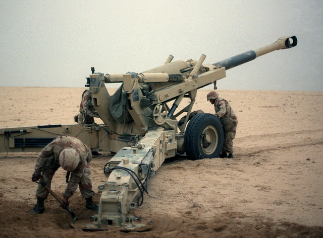 Marine artillerymen set up their M-198 155mm howitzer for a fire mission against Iraqi positions during Operation Desert Storm