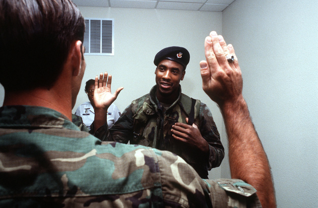 An airman re-enlists prior to deployment in support of Operation Desert Shield