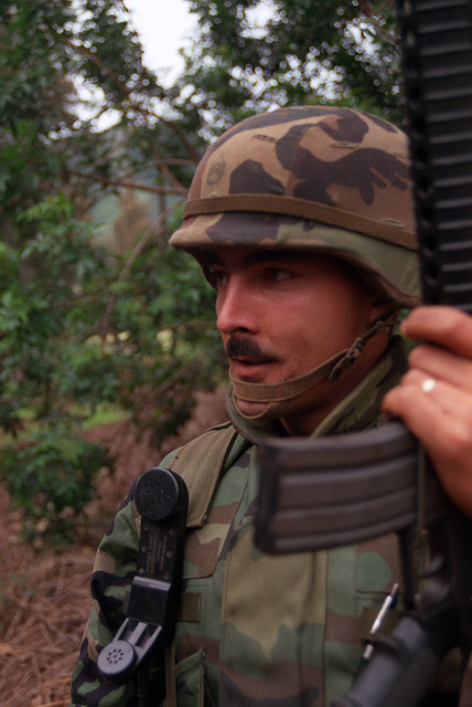 STAFF SGT. Warren Earling, Co. B, 4th Bn., 27th Inf., 25th Inf. Div. (Light), carries his M-16A2 rifle on patrol as he trains for deployment to the Middle East to take part in Operation Desert Storm