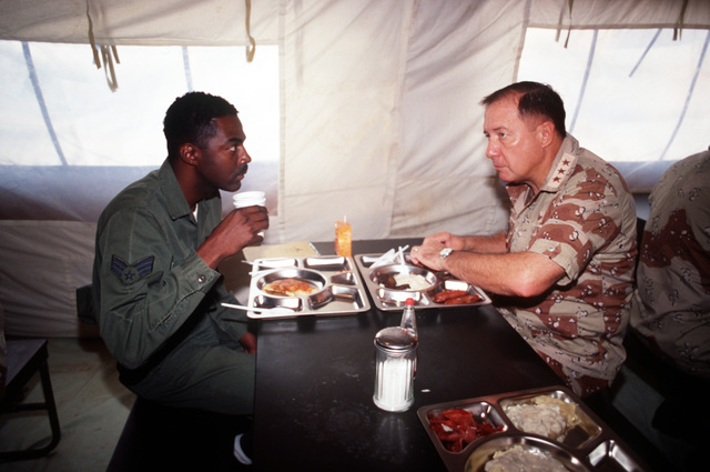 LT. GEN. Charles A. Horner, commander, U.S. Central Command Air Forces, eats breakfast with SGT. Charles Kimble, 55th Services Squadron, while visiting the 56th Tactical Air Command medical facility during Operation Desert Shield