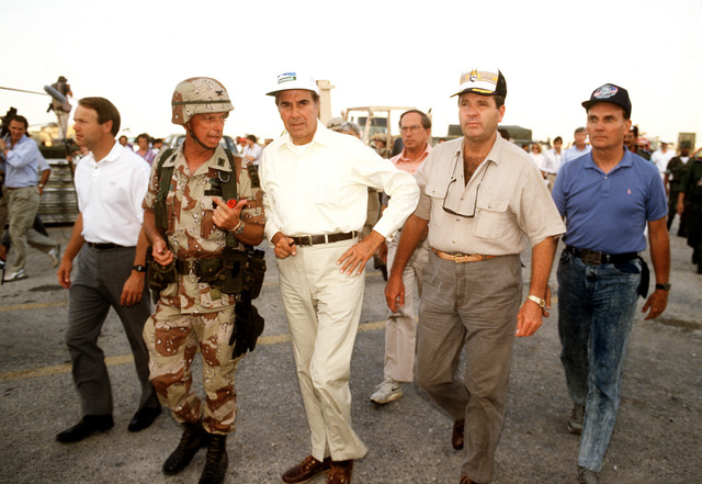 Sen. Robert Dole of Kansas, center, tours a military facility with other members of a congressional delegation during Operation Desert Shield