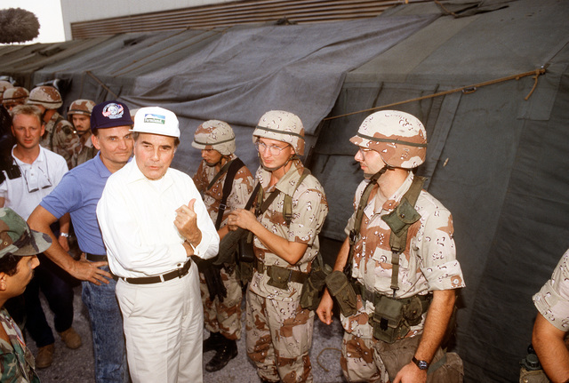 Sen. Robert Dole of Kansas, talks with a group of Soldiers while visiting a military facility with other members of a congressional delegation during Operation Desert Shield