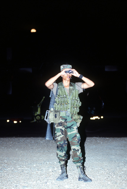 SGT. Alwin Scott Jr., 436th Security Police Squadron, uses night vision goggles to survey the surrounding territory during Operation Desert Shield