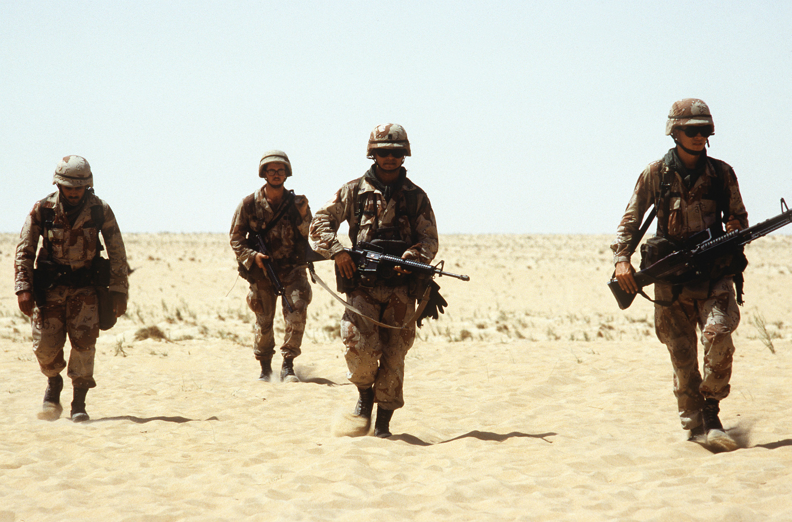 Soldiers from 1ST Bn., 505th Parachute Infantry Regt., 82nd Airborne Div., walk through a training range as they conduct reaction drills during Operation Desert Shield