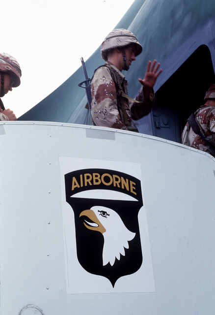 Soldiers from the 101st Airborne Division (Air Assault) board a transport aircraft that will take them to Saudi Arabia for Operation Desert Shield