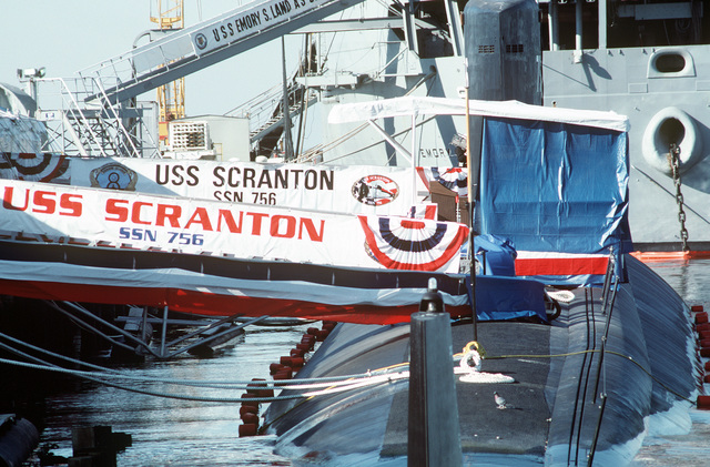 Banners decorate the brow of the nuclear-powered attack submarine USS SCRANTON (SSN-756) in preparation for the vessel's commissioning ceremony