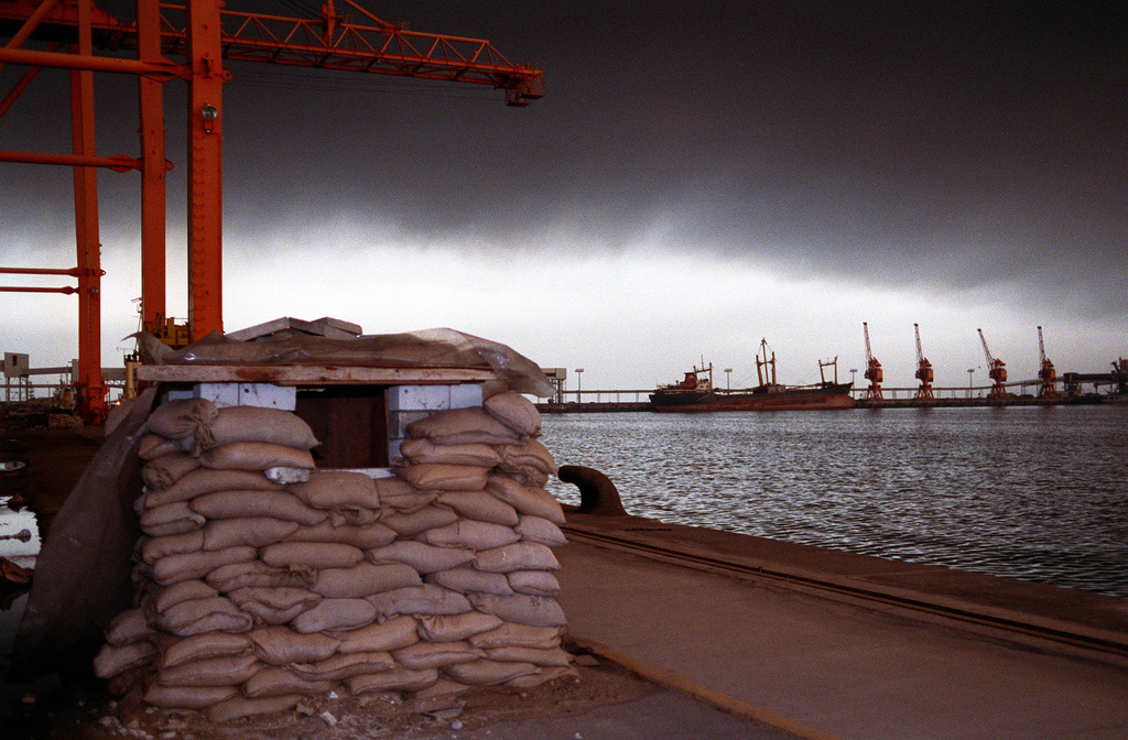 A former Iraqi defensive emplacement sits on a dock at the city's port facility following Operation Desert Storm
