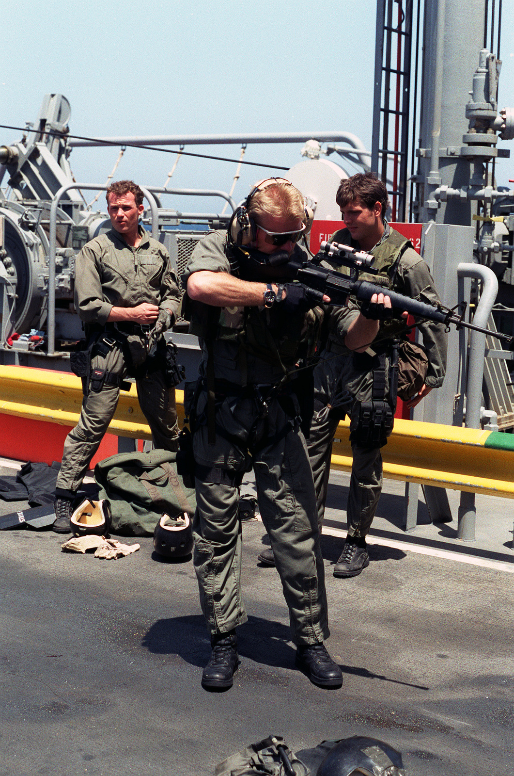 A member of Sea-Air-Land (SEAL) Team 8 sights through the