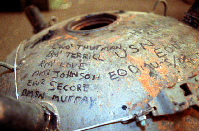 A view of an Iraqi mine that an explosive ordnance disposal (EOD) team found and disabled during mine-clearing operations on the Kuwaiti coast and in the Persian Gulf following Operation Desert Storm. The names of the EOD team's members are written on the mine