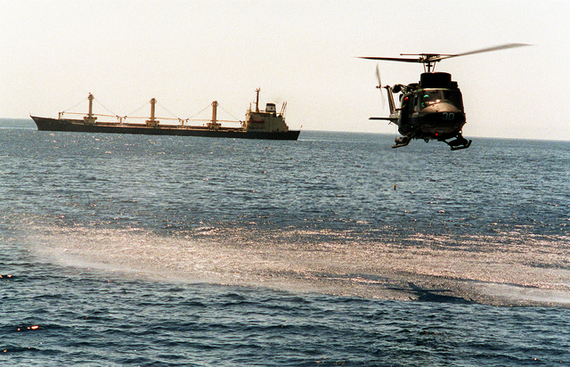 An Agusta-Bell 212 ASW helicopter assigned to the Greek frigate HS Limnos (F-451) returns to the ship after carrying a boarding party to a merchant vessel for an inspection. The Limnos is one of the ships of the Maritime Interdiction Force (MIF), which was formed during Operation Desert Shield to enforce U.S. sanctions against Iraq.