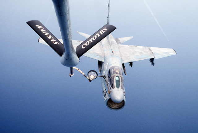 An Attack Squadron 72 (VA-72) A-7E Corsair II aircraft refuels from a KC-135 Stratotanker aircraft as the planes are in-flight over the Red Sea during Operation Desert Storm