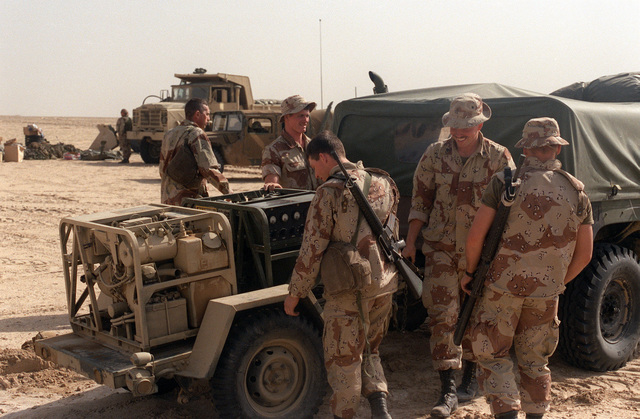 Marines from the 2nd Combat Engineer Battalion prepare to move a trailer-mounted generator into an emplacement at Task Force Breach Alpha's new position in northern Saudi Arabia during Operation Desert Storm.