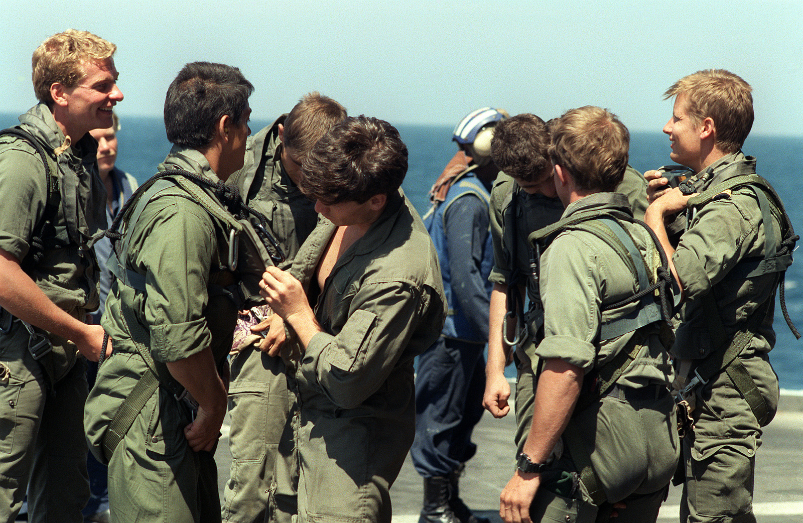 Members of Sea-Air-Land (SEAL) Team 8 and French commandoes prepare