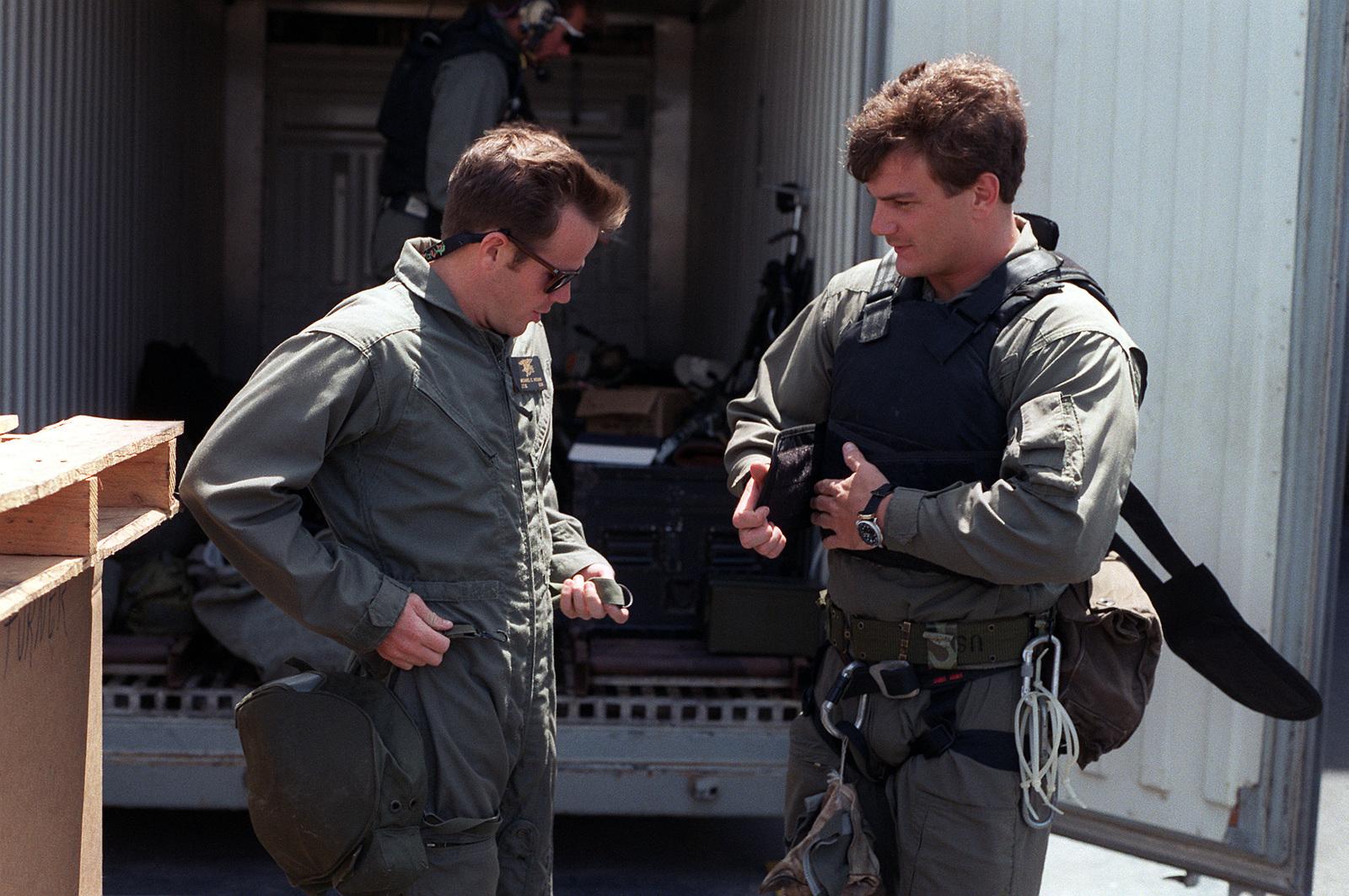 Members of Sea-Air-Land (SEAL) Team 8 prepare for a training