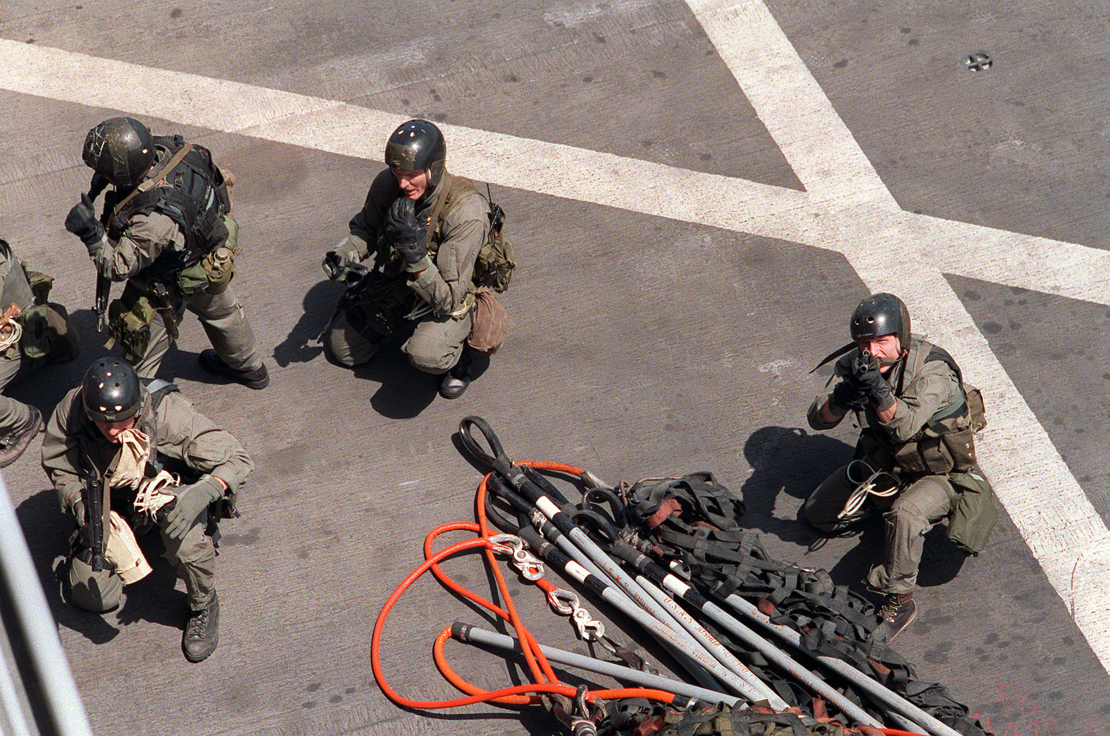 Members of Sea-Air-Land (SEAL) Team 8 prepare to move from the