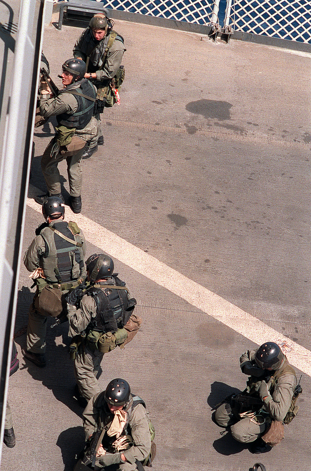 Members of Sea-Air-Land (SEAL) Team 8 prepare to move from