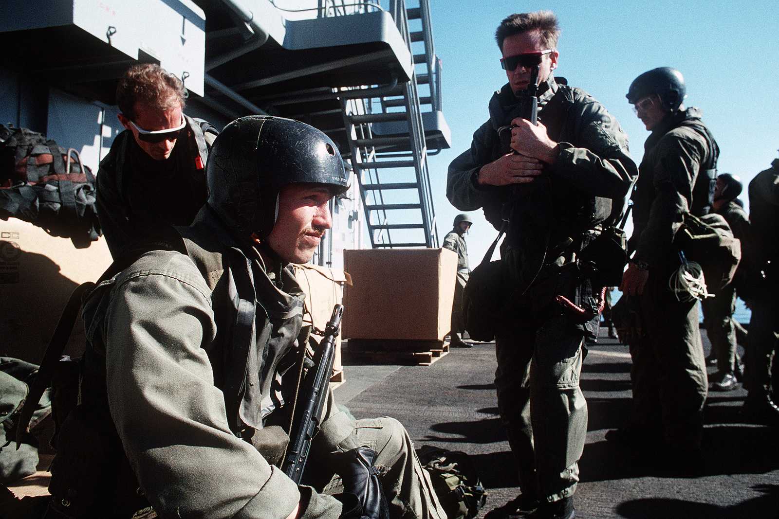 Members of Sea-Air-Land (SEAL) Team 8 stand by prior to a