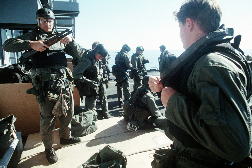 Members of Sea-Air-Land (SEAL) Team 8 strap on their