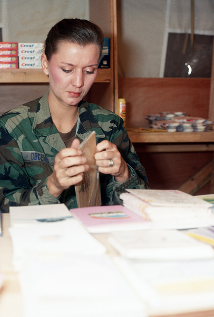 SGT. Shoana Obcemea, services specialist, unpacks a shipment of razors which has just arrived at the BX. The supplies are for use by U.S. military personnel during Operation Desert Storm.