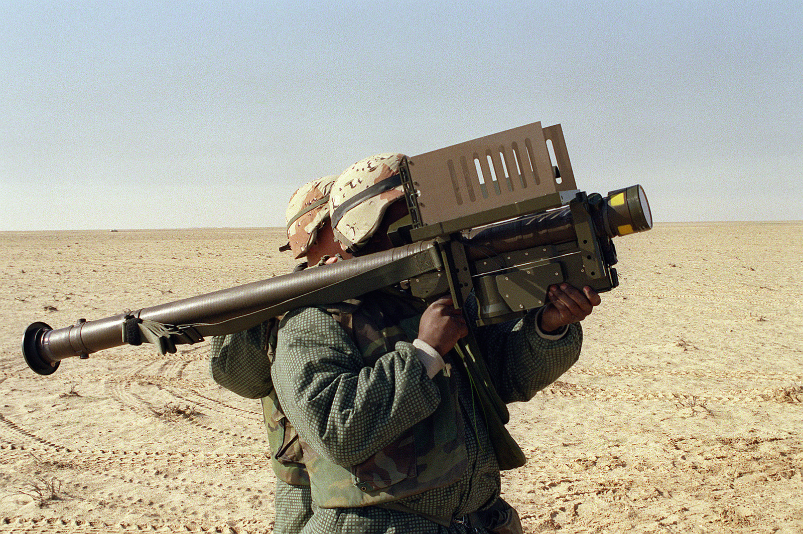 Two members of Stinger Plt., Headquarters Btry, 10th Marines, train with a FIM-92 Stinger anti-aircraft missile launcher during Operation Desert Storm. - U.S. National Archives Public Domain Image