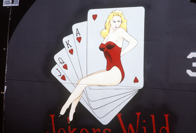 "A view of artwork entitled ""Jokers Wild"" on the nose of a KC-135 Stratotanker aircraft"