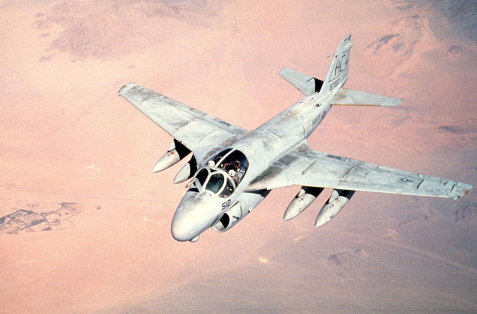 An A-6E Intruder aircraft flies over the desert as it prepares for refueling during Operation Desert Storm.