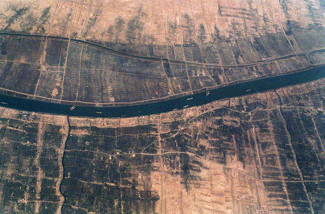 Disabled Iraqi ships block portions of a waterway during Operation Desert Storm.