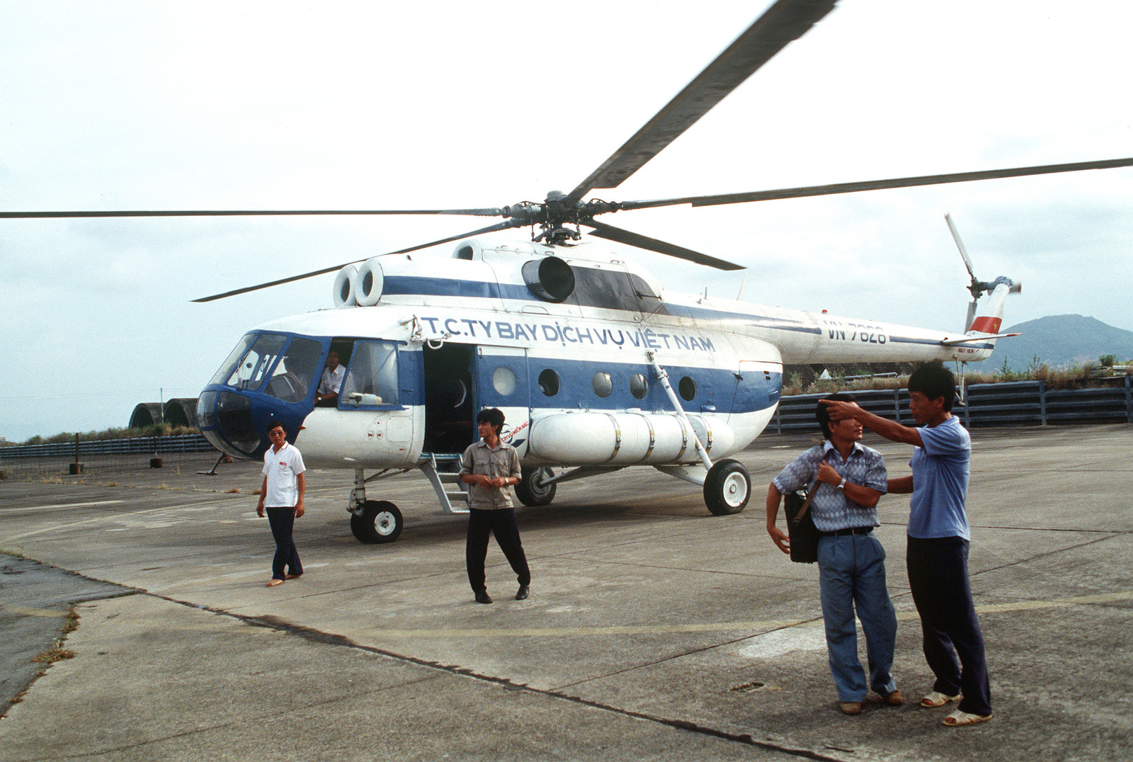 A Soviet-made Mi-8 Hip helicopter stands on the flight line after delivering representatives from the Joint Casualty Recovery Center (JCRC) to the area. JCRC personnel are in the region to work in conjunction with Vietnamese authorities gathering information on Doug Nua Mountain, Quang Binh Province, regarding an American pilot whose A-7 Corsair II aircraft crashed in the region during the Vietnam War.