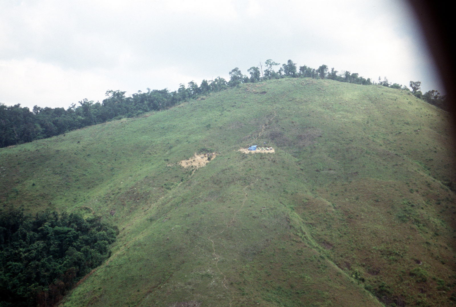 A view of a campsite occupied by Joint Casualty Recovery Center personnel and members of a joint U.S./Vietnamese anthropological team. Team members are conducting excavations in the area of Dong Nua Mountain, Quang Binh Province, in an effort to locate remains of an American pilot whose A-7 Corsair II crashed in the area during the war in Vietnam.