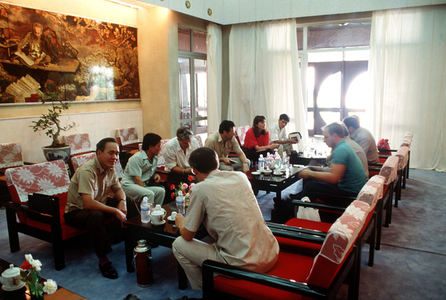 Vietnamese officials meet with members of a Joint Casualty Recovery Center anthropological team who have arrived to conduct a dig. Team members will be searching for the remains of an American pilot whose A-7 Corsair II aircraft crashed on Dong Nua Mountain, Quang Binh Province.