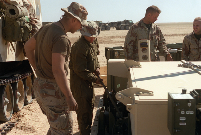 Marines assigned to Task Force Breach Alpha prepare a Mark 154 mine clearance kit for installation on an AAVP-7A1 amphibious assault vehicle during Operation Desert Storm. The Marines are from the 2nd Combat Engineer Battalion, 2nd Marine Division.