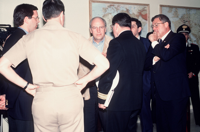 Officers and civilian officials speak with Secretary of Defense Richard Cheney during a brief stopover at the air station. Cheney and GEN. Colin Powell, chairman of the Joint Chiefs of STAFF, are en route to the Middle East on a fact finding mission during Operation Desert Storm
