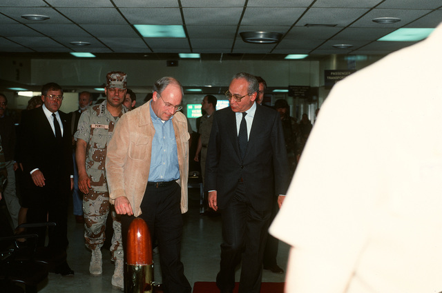 Secretary of Defense Richard Cheney and GEN. Colin Powell, chairman of the Joint Chiefs of STAFF, arrive at the air station for a brief stopover. The two men are en route to the Middle East on a fact finding mission during Operation Desert Storm