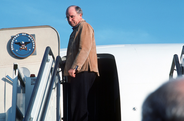 Secretary of Defense Richard Cheney departs from the air station after a brief stopover. Cheney and GEN. Colin Powell, chairman of the Joint Chiefs of STAFF, are en route to the Middle East on a fact finding mission during Operation Desert Storm