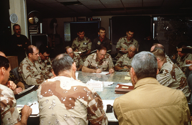 LT. GEN. Charles A. Horner, commander, U.S. Central Command Air Forces, makes notations while taking part in a conference during Operation Desert Storm.