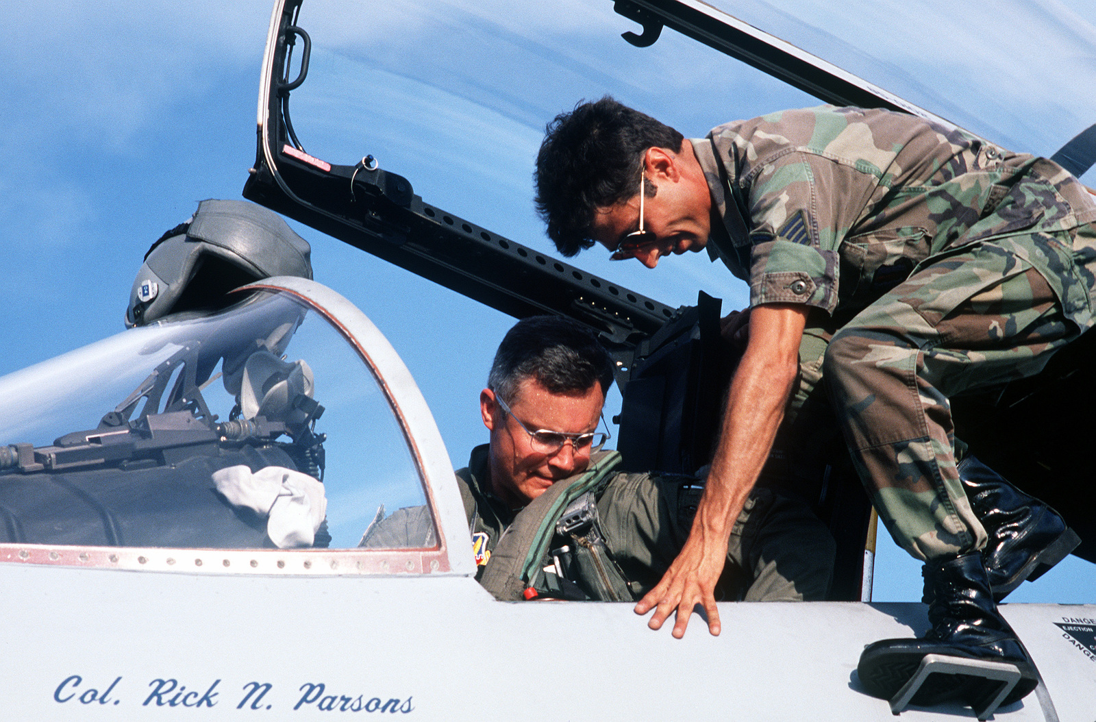 COL. Rick N. Parsons, commander, 33rd Tactical Fighter Wing, secures a safety belt in the cockpit of his F-15C Eagle aircraft as he prepares to deploy to the Middle East in support of Operation Desert Shield