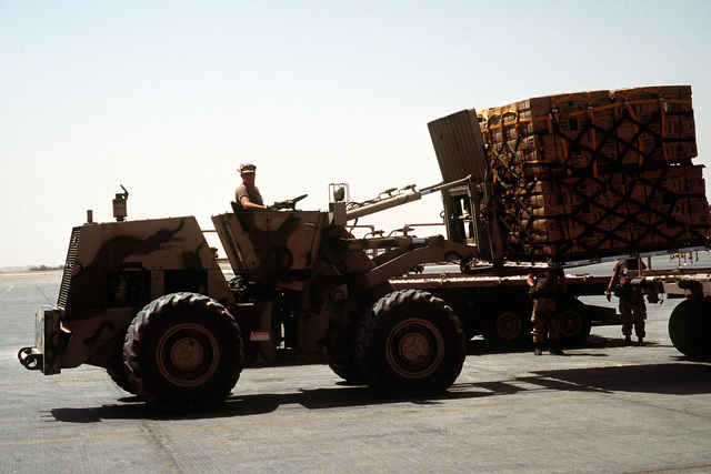 A ground crew member uses a forklift to move pallets of supplies in support of Operation Desert Shield